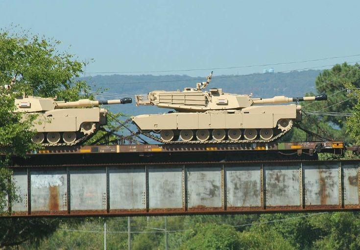 M1A1s on RR flatcars.